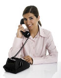 Speaking at the phone. Beautiful business woman speaking at the phone Stock Photos