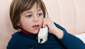 Speaking at the Phone. Cute little girl speaking at the phone Stock Images