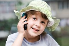 Speaking on the phone. An image of nice young girl speaking on the phone Royalty Free Stock Image