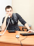 Speaking on phone in office Stock Photography