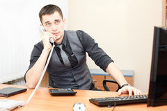 Speaking on phone in office Stock Photos