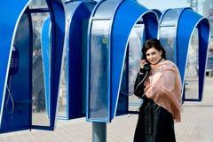 Speaking on telephone Stock Photography