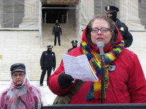 Speaking to the Crowd. Photo of pro life protester in downtown washington dc at the supreme court on 1/25/13. The woman speaker regrets her decision to have an royalty free stock photo
