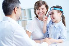 Speaking to the doctor Royalty Free Stock Image