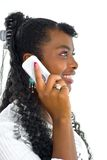 Speaking to white telephone's receiver Stock Photography