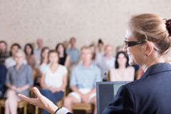 Speaking during training. Experienced businesswoman is speaking during training for workers Royalty Free Stock Image
