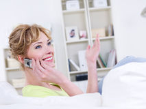 Speaking woman with mobile Stock Photo