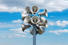 Speakres. A pile of loudspeakrs against cloudy blue sky Stock Image