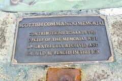 Spean Bridge , Scotland - May 31 2017:Sign explaining the contribution box of the Commando Memorial. SPEAN BRIDGE , SCOTLAND - MAY 31 2017:: Sign explaining the Royalty Free Stock Photography