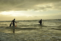 Spear Fishermen. Spearfishing in ocean as a team royalty free stock image