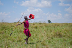 Spear throwing Maasai Man. A maasai warrior dressed in traditional clothes throwing a spear Royalty Free Stock Image