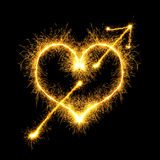 Speared sparking heart Stock Photos