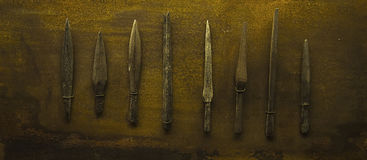 Spearheads. Several genuine historical spearheads, mounted on a background Stock Photography
