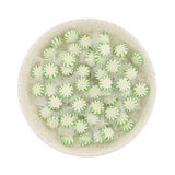 Spearmint starlight mints in a shallow bowl Stock Photography