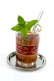Spearmint Tea. Marroccan green tea with spearmint on light background royalty free stock image