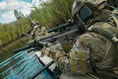 Spec ops in the military kayak. Special forces operators in the military kayak Royalty Free Stock Photos