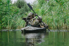 Spec ops in the military kayak royalty free stock photography