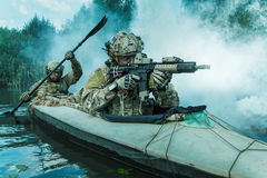 Spec ops in the military kayak royalty free stock image