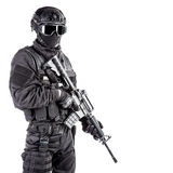 Spec ops police officer SWAT. In black uniform and face mask Stock Photography