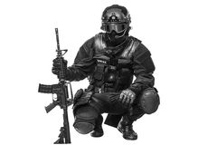 Spec ops police officer SWAT. In black uniform and face mask studio shot Stock Photo