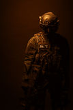 Spec ops police officer SWAT. In black uniform and face mask studio shot Royalty Free Stock Photography