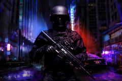Spec ops police officer. SWAT in black uniform on the street Royalty Free Stock Photo