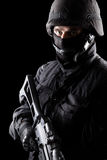 Spec ops soldier on black background Stock Photos