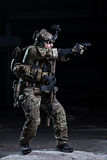 Spec ops soldier with pistol Stock Photo