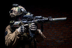 Spec ops soldier in uniform with assault rifle royalty free stock image