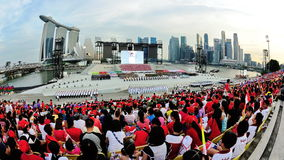Specators watching military ceremony proceedings during National Day Parade (NDP) Rehearsal 2013 Stock Photos