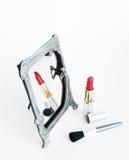 Specchio, rossetto e spazzola Fotografie Stock