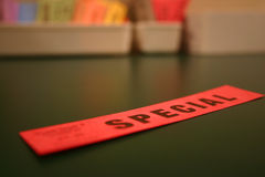 Special. Tag from a dry cleaners, red on green surface Royalty Free Stock Images