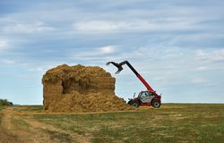 A special agricultural vehicle stores straw. And blue sky Royalty Free Stock Photo
