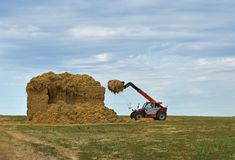 A special agricultural vehicle stores straw. And blue sky Stock Photos
