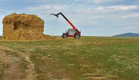 A special agricultural vehicle stores straw. And blue sky Royalty Free Stock Photography