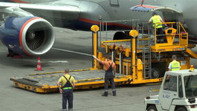 Special airport employee to alert the driver of the truck traffic airplane.  stock video footage