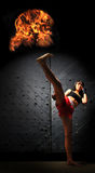 Special Asian Woman Practising Muay Thai Boxing. Young Asian Woman Practising Muay Thai Boxing in an underground tunnel with fire ball flames Stock Photos