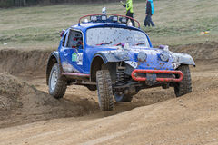Special blue off road car is in the turn in terrain Royalty Free Stock Photography