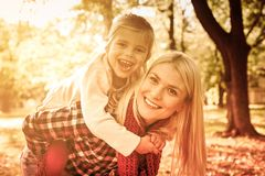 Special bond between mother and daughter. Smiling mother and her daughter in park. Close up royalty free stock photography
