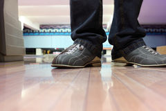 Special boots for bowling on feet Royalty Free Stock Photo