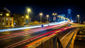 Special bridge in bratislava, slovakia. At night with traffic lights lines Stock Photo