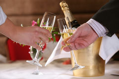 Special Champagne Toast. A couple making a champagne toast to celebrate at an elegant and special event royalty free stock photo