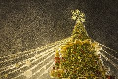 A special Christmas season is here!. Cropped shot of a beautifully decorated Christmas tree with snow against the dark sky Royalty Free Stock Images