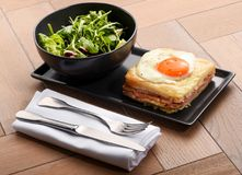 Special club sandwich served with rocket salad Royalty Free Stock Photos