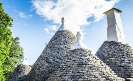 Free Special Conical Roofs Of The Trulli In Cisternino On The Blue Background Of The Sky. Royalty Free Stock Image - 134444996
