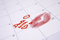 A Special Date!. An appointment with a loved one marked in red on the calendar with a lipstick kiss royalty free stock photos