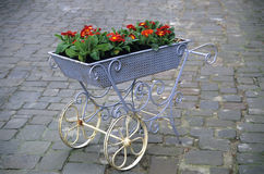 Special Delivery. A cart full of flowers in Brugges, Belgium royalty free stock photo