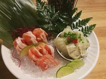 Special Deluxe Combination sashimi set Salmon, Engawa and seaweed on ice sever with wasabi and lime, Japanese food Stock Images
