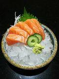 Special Deluxe salmon sashimi set  on ice sever with wasabi and cucumber , traditional Japanese food Stock Image