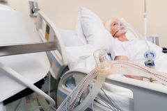Special device assisting old lady breathing Royalty Free Stock Photography